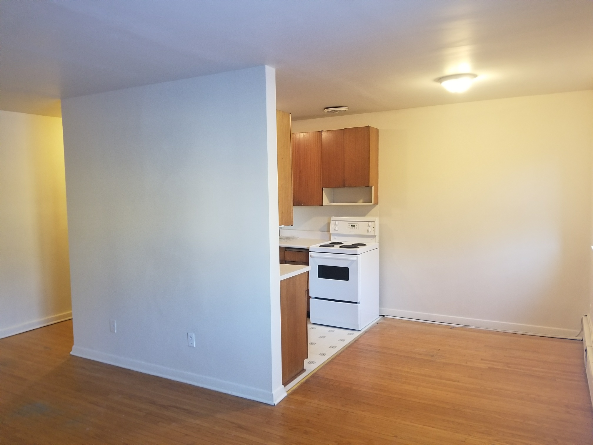 Towers Realty Group - Crescent Towers - 671 McMillan Ave - Living-Dining-Kitchen