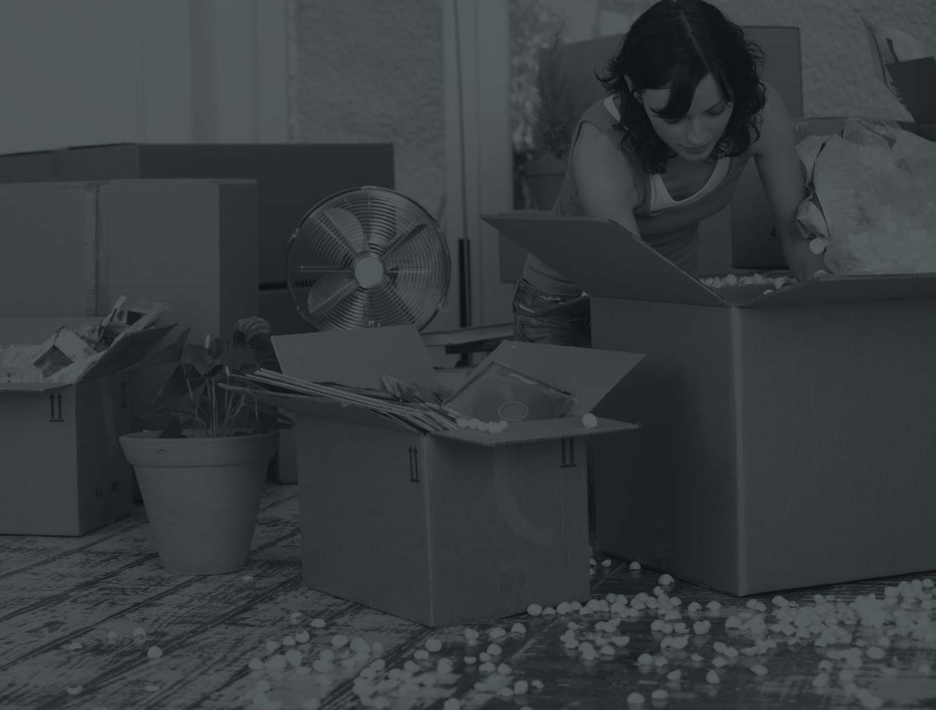black and white image of woman unpacking