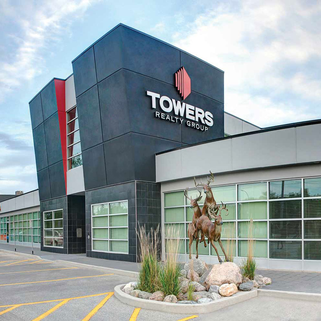 towers realty group building front with running deer statues